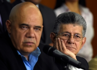 "The secretary general of the Democratic Unity Roundtable (MUD), Jesus ""Chuo"" Torrealba (L), and the president of the Venezuelan National Assembly, Henry Ramos Allup , offer a press conference in Caracas on March 8, 2016. Venezuela's opposition called for the ""largest movement that has ever existed"" to oust President Nicolas Maduro, vowing to pursue all means to force him from power. The opposition, which has been on a collision course with Maduro since winning control of the legislature in December, spent weeks deciding on its strategy to remove the deeply unpopular socialist president -- whether through a referendum, a constitutional amendment or the drafting of a new constitution. AFP PHOTO / JUAN BARRETO / AFP / JUAN BARRETO"